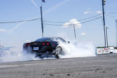 Corvette smoke show. Napierville dragway, canada - june 7, 2014 picture of chevrolet corvette during smoke show at heads up challenge event Stock Photography