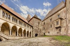Corvin`s Hunyadi Castle in Hunedoara, Romania. Corvin`s Hunyadi Castle`s interior court. A historic monument and major tourist attraction in Hunedoara, Romania Stock Images