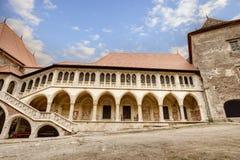Corvin`s Hunyadi Castle in Hunedoara, Romania. Corvin`s Hunyadi Castle`s interior court. A historic monument and major tourist attraction in Hunedoara, Romania Stock Photos