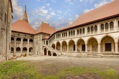 Corvin`s Hunyadi Castle in Hunedoara, Romania. Corvin`s Hunyadi Castle`s interior court. A historic monument and major tourist attraction in Hunedoara, Romania Stock Images