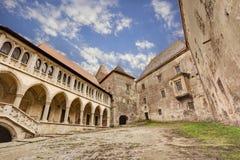 Corvin`s Hunyadi Castle in Hunedoara, Romania. Corvin`s Hunyadi Castle`s interior court. A historic monument and major tourist attraction in Hunedoara, Romania Royalty Free Stock Photos