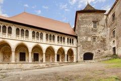 Corvin`s Hunyadi Castle in Hunedoara, Romania. Corvin`s Hunyadi Castle`s interior court. A historic monument and major tourist attraction in Hunedoara, Romania Royalty Free Stock Photo