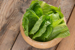 Cos lettuce in wood bowl. Stock Photography