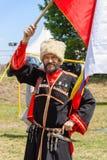 Cosaco ruso con la bandera rusa Fotos de archivo libres de regalías