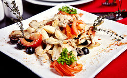 Cosce di rane fritte sul piatto Fotografie Stock