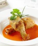Coscie di pollo con la salsa di paprica Immagine Stock Libera da Diritti