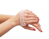 Cose-up image of female hands with a necklace Royalty Free Stock Images