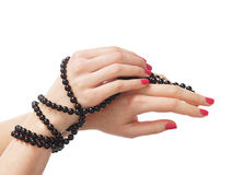Cose-up image of female hands with a necklace Stock Images