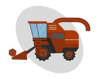 Cosechadora industrial del tractor de la maquinaria del equipamiento agrícola de la agricultura y coche rural rojo del maíz de la Fotografía de archivo
