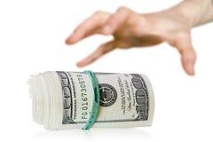 Cosegni i soldi fotografia stock