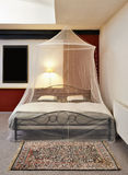 Cosi vintage bed with mosquito Net Royalty Free Stock Images