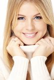 Cosiness. Smiling girl in the white sweater, isolated royalty free stock image