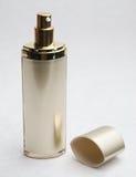 _cosmético poner crema botella y tapa Imagen de archivo
