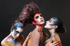 Cosméticos creativos en mujeres hermosas Imágenes de archivo libres de regalías
