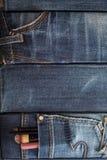 Cosméticos, escovas da composição em um bolso das calças de brim fotos de stock royalty free