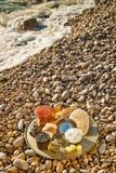 Cosméticos naturales en la playa Foto de archivo