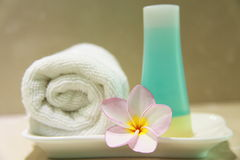 Cosmetic. Lotion, bloom and towel, taken at a Thai Spa Stock Photos