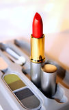 Cosmetic. Set of cosmetic - red lipstick and eye shadow Royalty Free Stock Photo