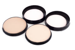Cosmetic accessories. Face powder in front of white background Stock Images