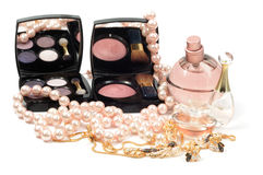 Cosmetic accessory. Perfumes,  eyeshadow and jewelry on white background Stock Images
