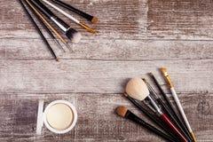 Cosmetic applicators and jar of cream Stock Photos