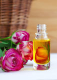 Cosmetic aroma oil with rose essence Royalty Free Stock Image