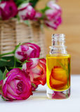 Cosmetic aroma oil with rose essence Royalty Free Stock Photography