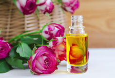 Cosmetic aroma oil with rose essence. Small bottle of cosmetic aroma oil with rose essence Royalty Free Stock Photos