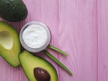 cosmetic avocado cream on pink wood royalty free stock image