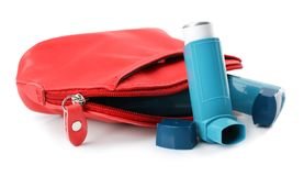 Cosmetic bag with asthma inhalers. On white background Royalty Free Stock Images