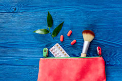 Cosmetic bag with contraceptive pills on blue table background top view copyspace Stock Images