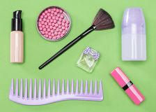 Cosmetic bag essentials. Comb, makeup foundation, blush, lipstick, deodorant, perfume, make up brush Royalty Free Stock Images