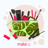 Cosmetic bag with a pattern of tropical leaves. Cosmetic bag with tools for professional make-up: lipstick, mascara. Vector illustration Royalty Free Stock Images