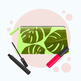 Cosmetic bag with a pattern of tropical leaves. Cosmetic bag with tools for professional make-up: lipstick, mascara. Vector flat illustration Stock Photography