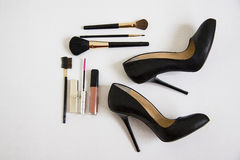 Cosmetic and black shoes Royalty Free Stock Photo