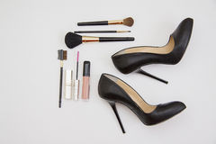 Cosmetic and black shoes Stock Image