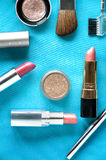 Cosmetic on blue background Royalty Free Stock Images