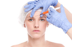 Cosmetic botox injection in face. Cosmetic botox injection in the female face. Eye and eyebrow zone. Isolated on white royalty free stock photos