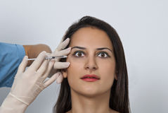 Cosmetic botox injection in the female face Stock Photo