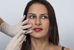 Cosmetic botox injection in the female face. Cosmetic botox injection to female face Royalty Free Stock Image