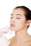 Cosmetic botox injection in the female face Stock Images