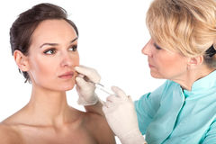 Cosmetic botox injection in the female face Royalty Free Stock Photography