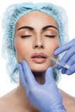 Cosmetic botox injection to the pretty woman face Royalty Free Stock Images