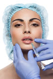 Cosmetic botox injection to the pretty woman face Stock Photo