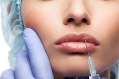 Cosmetic botox injection to the pretty woman face Stock Photography