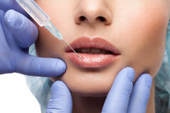 Cosmetic botox injection to the pretty woman face stock photos