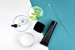 Cosmetic bottle containers with green herbal leaves, Blank label for branding mock-up, Natural beauty product concept. Cosmetic bottle containers with green royalty free stock photo