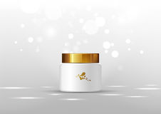 Cosmetic bottle for cream. White jar and gold glossy lid on the gray background for ads. Stock Image