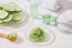 Cosmetic bottle and fresh organic cucumber for skincare. Home sp stock images