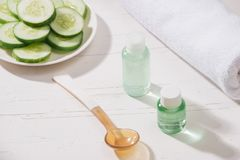Cosmetic bottle and fresh organic cucumber for skincare. Home sp royalty free stock photos